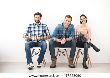Skillful young team is resting in room - stock photo