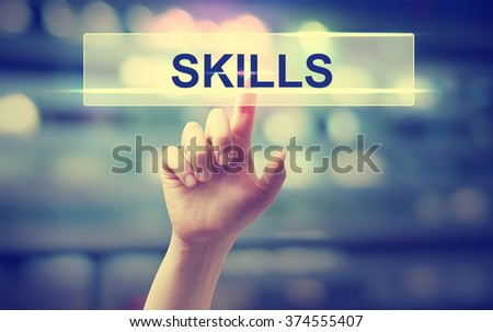 Skills concept with hand pressing a button on blurred abstract background
