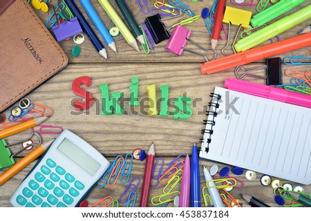 Skills word and office tools on wooden table - stock photo