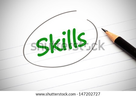 Skills word written in green on a notepad and circled