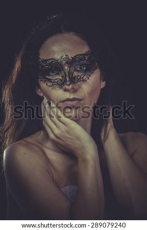 Skin, brunette woman in black mask metal frills - stock photo