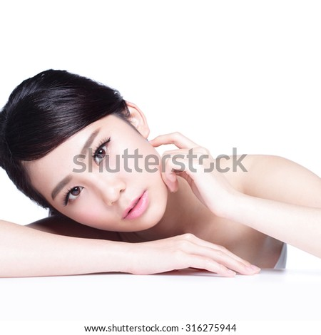 Skin care beauty woman face Smile to you close up while lying isolated on white background, asian girl