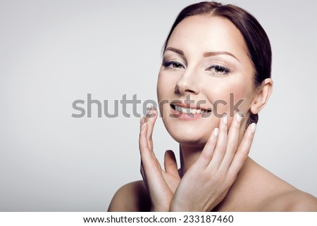 Skin care beauty woman  smiling happy and cheerful. Caucasian female beauty model with perfect shining skin isolated on neutral background.  - stock photo