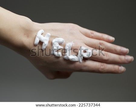 Skin Care Concept / Help Note with Moisturizer Cream on Dry Skin Hand  - stock photo