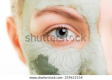 Skin care. Woman in clay mud mask on face isolated on white. Girl taking care of dry complexion. Beauty treatment. - stock photo