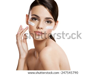 Skin care woman putting face cream / photo composition of brunette girl  - isolated on white background  - stock photo