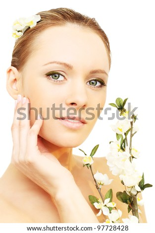 Skin care - woman with spring flowers isolated on white background - stock photo