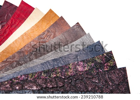 skin samples in a variety of colors. colored leather - stock photo