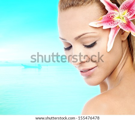 Skincare of young woman with fresh flower