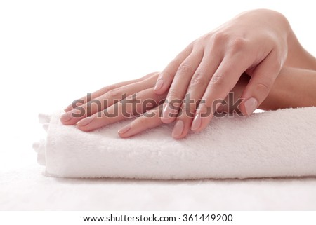 Skincare. Soft and clean hands on a white towel - stock photo