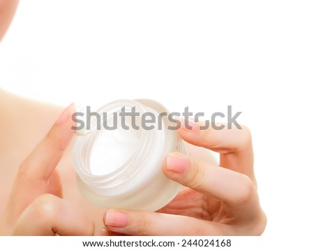 Skincare. Woman taking care of her dry complexion. Moisturizing cream in female hands isolated. Beauty treatment.