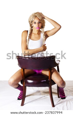 Skinny African American Woman Sitting Chair Backwards - stock photo