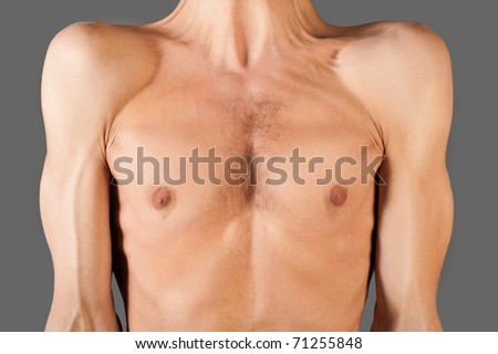 Skinny male torso. Studio shot Isolated on gray background