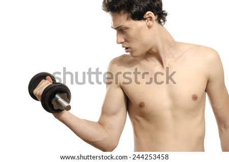 Skinny man training his bicep muscle. Beautiful teenager lifting a dumbbell.Anorexic young man training to become stronger - stock photo