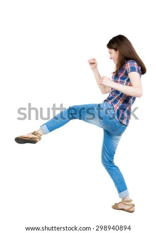 skinny woman funny fights waving his arms and legs. Isolated over white background. A young girl in a checkered blue with red stripes hit the right foot. - stock photo