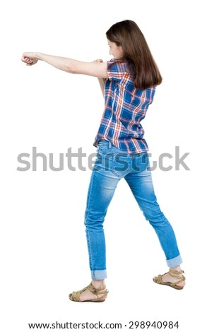 skinny woman funny fights waving his arms and legs. Isolated over white background. A young girl in a checkered blue with red stripes student punched. - stock photo