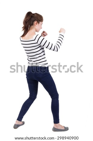 skinny woman funny fights waving his arms and legs. Isolated over white background. Frenchwoman in vest standing in a boxing pose. - stock photo