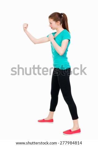 skinny woman funny fights waving his arms and legs. Isolated over white background. Girl in sportswear in sparring - stock photo