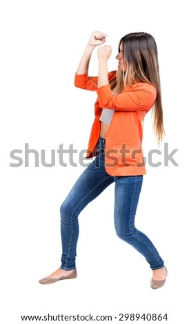 skinny woman funny fights waving his arms and legs. Isolated over white background. The girl in the red jacket standing in a boxing pose protecting her face from the blow. - stock photo
