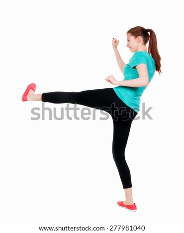 skinny woman funny fights waving his arms and legs. Rear view people collection.  backside view of person.  Isolated over white background. Girl in sportswear with a smile beats foot. - stock photo