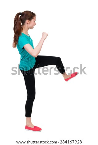 skinny woman funny fights waving his arms and legs. Rear view people collection.  backside view of person.  Isolated over white background. Sportswoman doing an intense workout. - stock photo