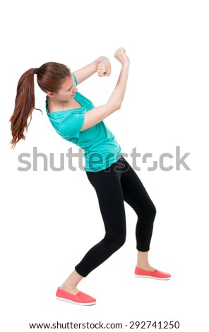 skinny woman funny fights waving his arms and legs. Rear view people collection.  backside view of person.  Isolated over white background. Sportswoman in tights deviates from the impact. - stock photo