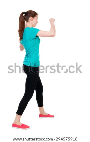 skinny woman funny fights waving his arms and legs. Rear view people collection.  backside view of person.  Isolated over white background. Sportswoman in tights coached impact protection. - stock photo