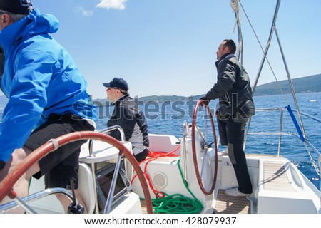"Skipper managing yacht. Tivat, Montenegro - 26 April, 2016 Regatta ""Russian stream"" in God-Katorskaya bay of the Adriatic Sea off the coast of Montenegro."