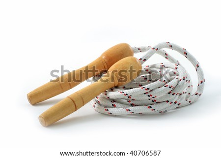 Skipping rope with wooden  handles isolated on white background