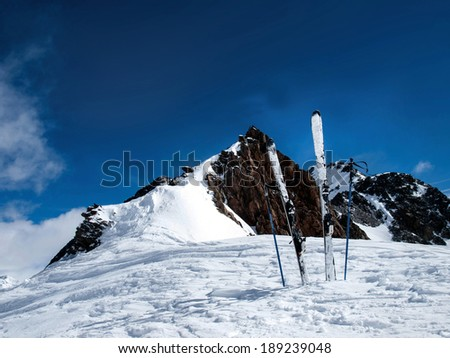 skis with poles on background of mountains - stock photo