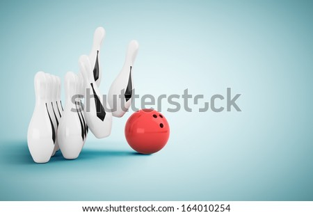 skittle and bowling ball on blue floor - stock photo