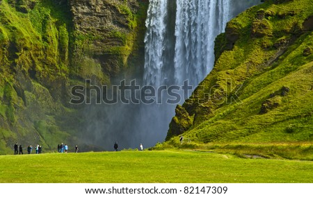 Skogafoss falls and rainbow in Iceland - stock photo