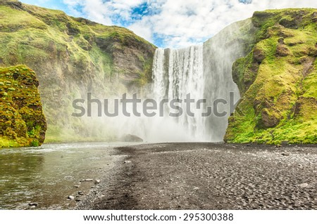 Skogafoss is a well known Icelandic waterfall on the South of the Iceland near the town Skogar - stock photo