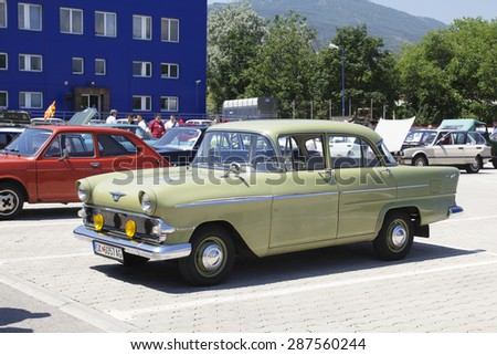 SKOPJE, MACEDONIA - JUNE 13, 2015: Unrecognizable people look around vintage cars on 10th Old Timer Car Show. The event organized by Euroimpex from Skopje.