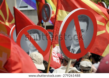 SKOPJE, MACEDONIA - MAY 17: Protesters from many ethnic groups and association for human rights demanding a resignation of Prime minister Nikola Gruevski on May 17, 2015 in Skopje, Macedonia. - stock photo