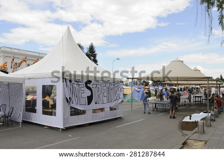 SKOPJE, MACEDONIA - MAY 25: Protesters settled a camp in front of government building demanding a resignation of Prime minister Nikola Gruevski on May 25, 2015 in Skopje, Macedonia. - stock photo