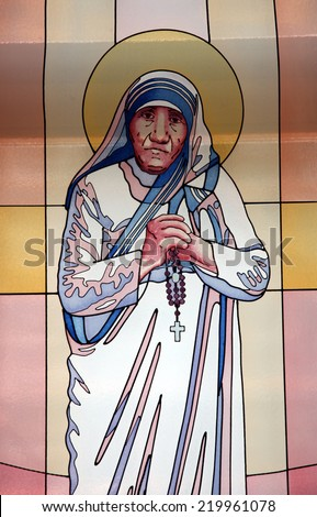 SKOPJE, MACEDONIA - MAY 17: Stained glass window with the image of Mother Teresa in the Memorial House in Skopje, Macedonia on May 17, 2013 - stock photo
