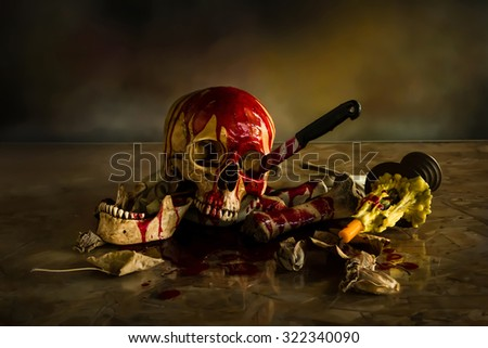 Skull abused with knife, Still Life style - stock photo