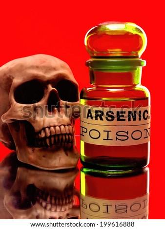 Skull and bottle of arsenic. - stock photo