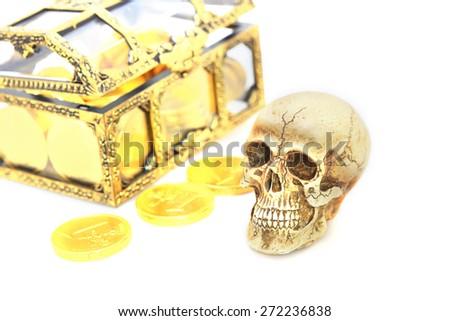 Skull and gold coins - stock photo