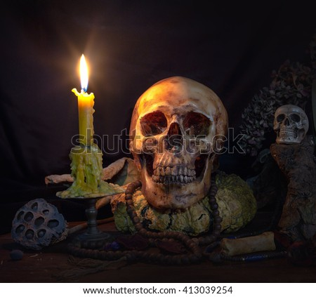 Skull and ritual on dark night with candle light / Image Still life style - stock photo