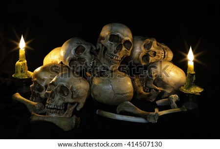 Skull and ritual on dark night with candle light / Image Still life style