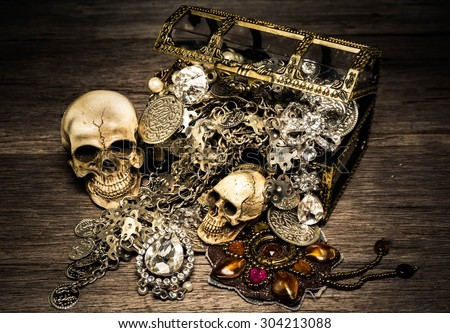 Skull and treasure chest on the old wooden table ,Vintage style, still life - stock photo