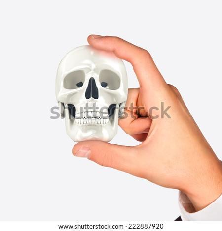 Skull in hand. High resolution. 3D render - stock photo