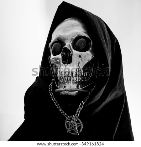 Skull of a human size robot isolated on black - stock photo