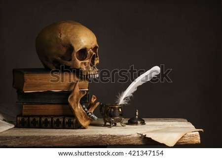 Skull on old Books with empty Page, Feather and Inkpot - stock photo