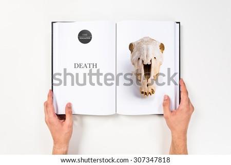 skull printed on book - stock photo