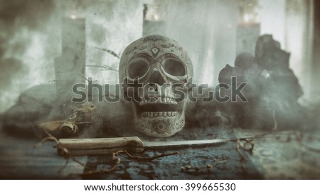 Skull Voodoo Smoke Ritual. Voodoo related objects on a table including a skull, a knife and candles. Smoke or mist. - stock photo