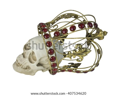 Skull wearing a golden crown with red jewels in it - path included - stock photo
