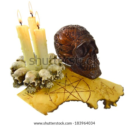 Skull with burning candles isolated - stock photo